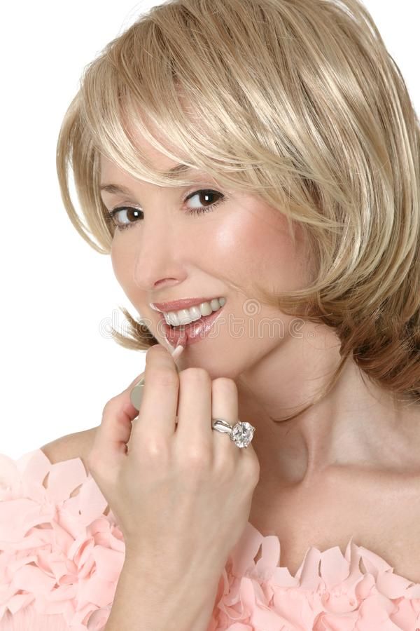 A touch of lipgloss royalty free stock images