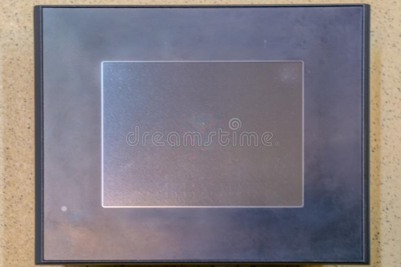 Touch panel. Black LCD screen on the stone texture stock images