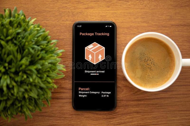 Touch phone with app tracking delivery package on the screen stock photos