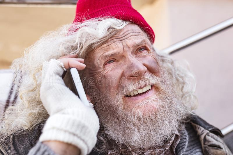 Portrait of a cheerful homeless man stock photography