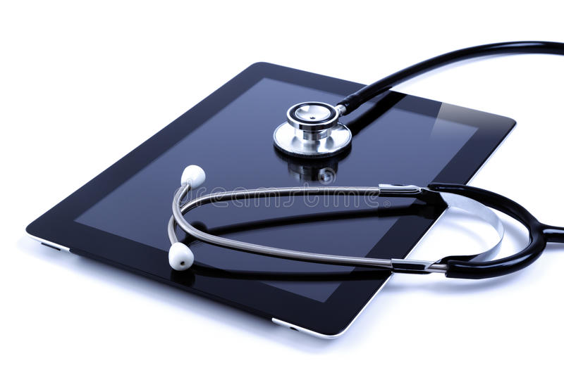 Touch screen digital tablet with stethoscope royalty free stock photos
