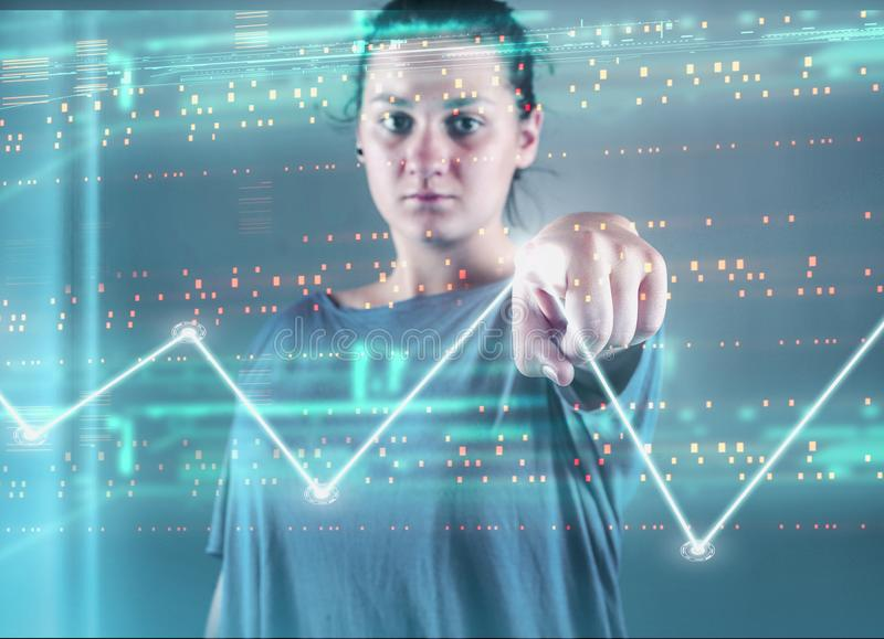 Touch screen graph. Woman pressing on a touch screen with bytes and a graph . Futuristic user interface royalty free stock image