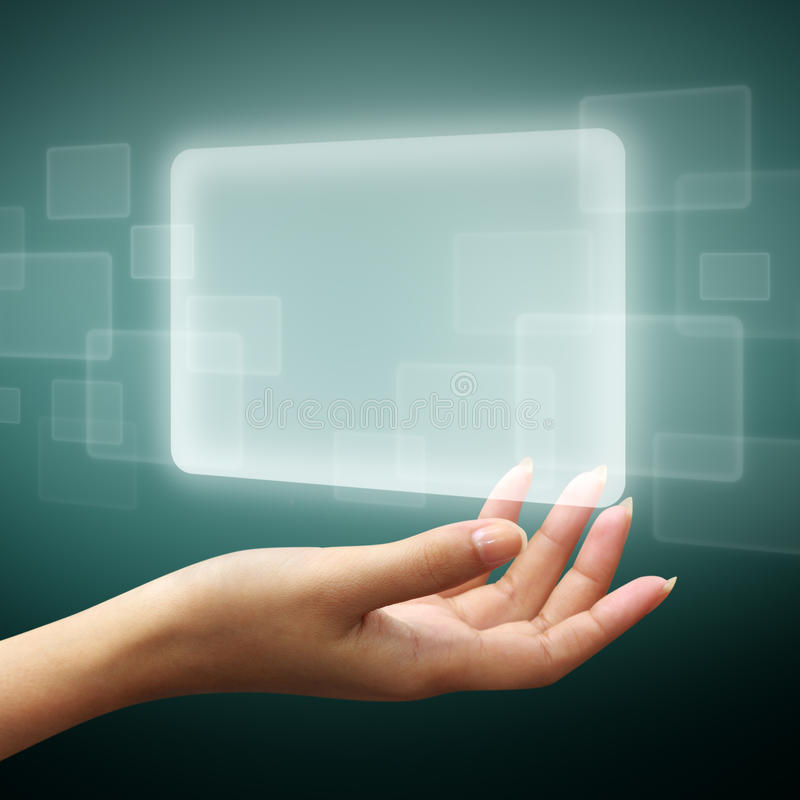 Touch screen interface on woman hand. On blue background stock photography