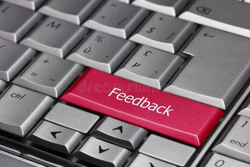 Touche d'ordinateur rouge montrant la rétroaction de mot photos libres de droits