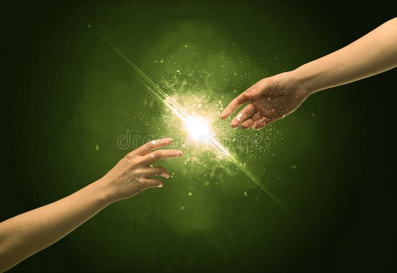 Touching arms lighting spark at fingertip royalty free stock photo