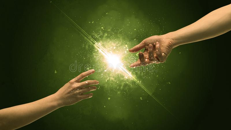 Touching arms lighting spark at fingertip stock photos
