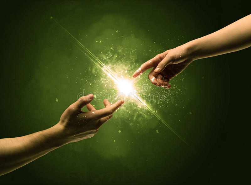 Touching arms lighting spark at fingertip. Two naked male hands about to touch, lighting the spark with modest explosion in front of green background concept royalty free stock photo
