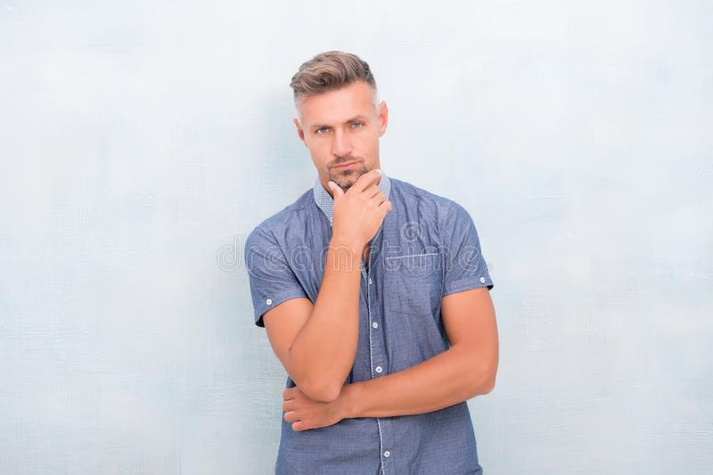 Touching chin. Man mature good looking model. What does it mean being macho. Barber hairdresser. Bristle and facial hair royalty free stock photo
