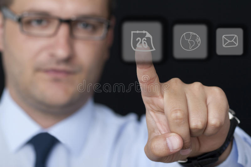 Touching the Glass Button. In the Office royalty free stock photo