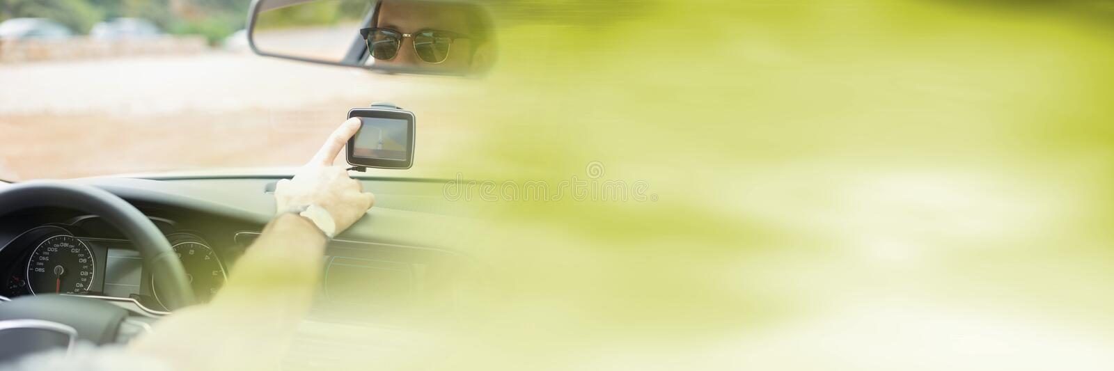 Touching GPS in car with transition effect stock photography
