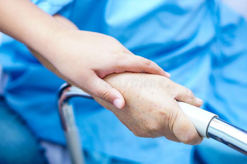Touching hands Asian senior or elderly old lady woman patient with love, care, helping, encourage and empathy. Touching hands Asian senior or elderly old lady royalty free stock image