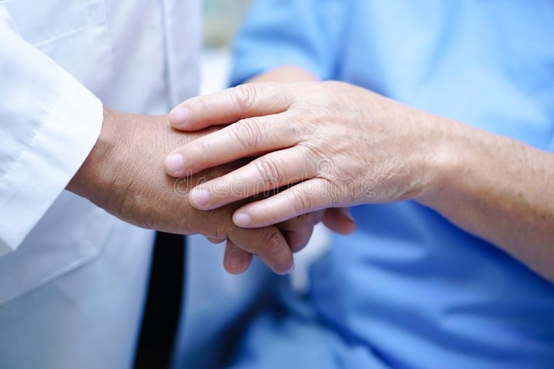 Touching hands Asian senior or elderly old lady woman patient with love, care, helping, encourage and empathy. Touching hands Asian senior or elderly old lady royalty free stock images