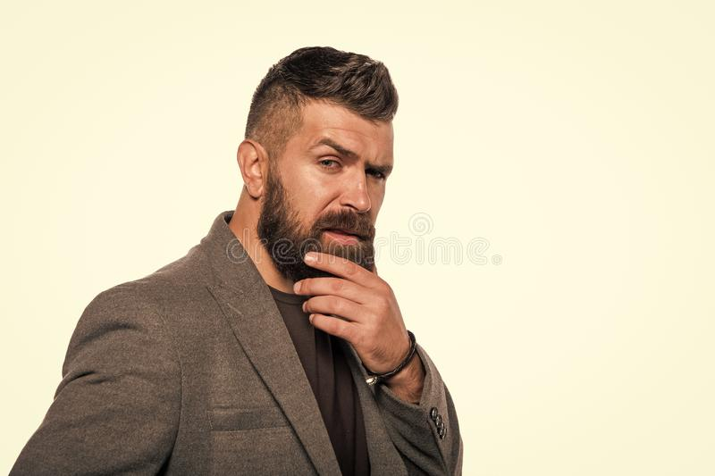 Touching his perfect beard. Hair and beard care. Bearded man. Mature hipster with beard, copy space. Male barber care royalty free stock photos