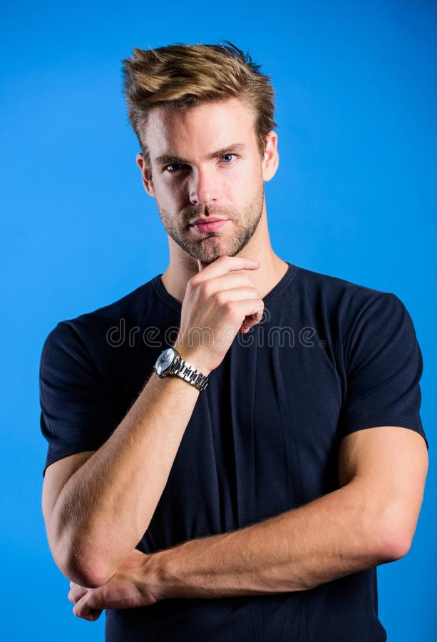Touching his perfect beard. Unshaven guy. fashion model. Casual style. Mens sexuality. Barbershop concept. Guy in denim. Clothes. handsome man. Confidence and royalty free stock image
