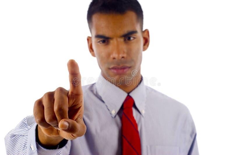 Touching Imaginary Screen. Young & Confident African American / Hispanic, Latin Mixed Business Man Touching an Imaginary Screen - Isolated over a white stock photos