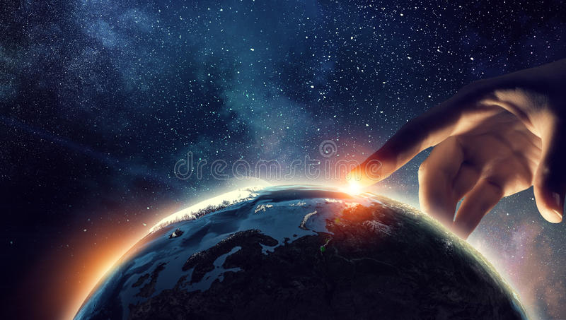 Touching planet with finger stock image