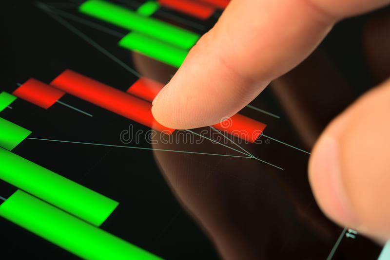 Download Touching Screen Of Tablet Pc With Market Graph Stock Image - Image: 26781711