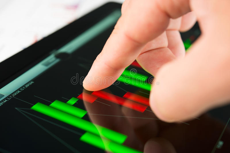 Touching Screen Of Tablet Pc With Market Graph Stock Photos