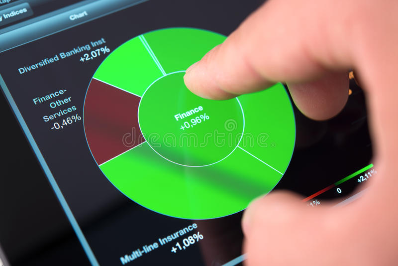 Download Touching Screen Of Tablet Pc With Market Graph Stock Image - Image: 26923959