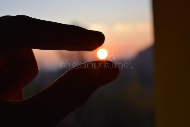 Touch the sun with my hand stock images