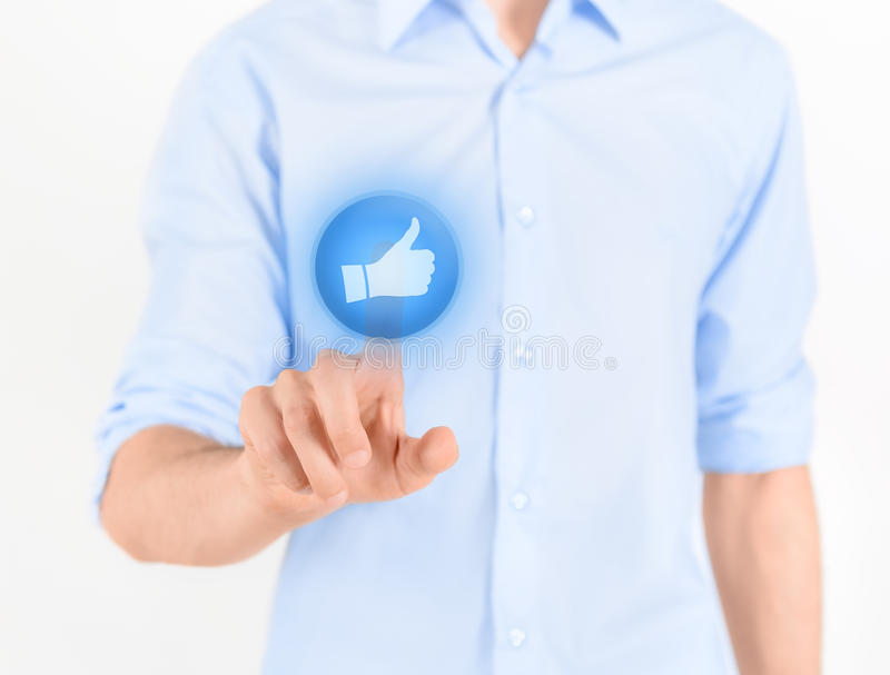 Touching Thumb Up Button stock image