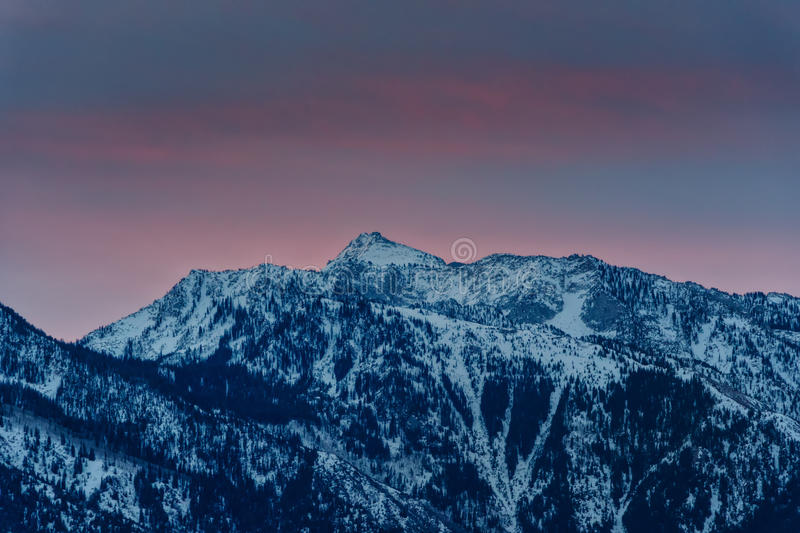 Touching the Wasatch. Sunrise over Lone Peak ( Wasatch National Forest)in the spring above Cottonwood Heights Utah USA stock images