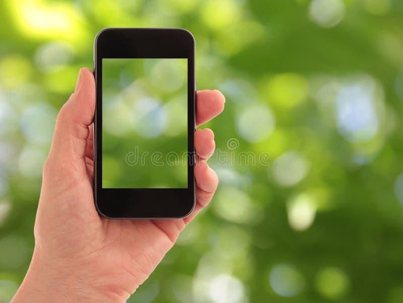 touchphone мобильного телефона франтовское прямое стоковые фото
