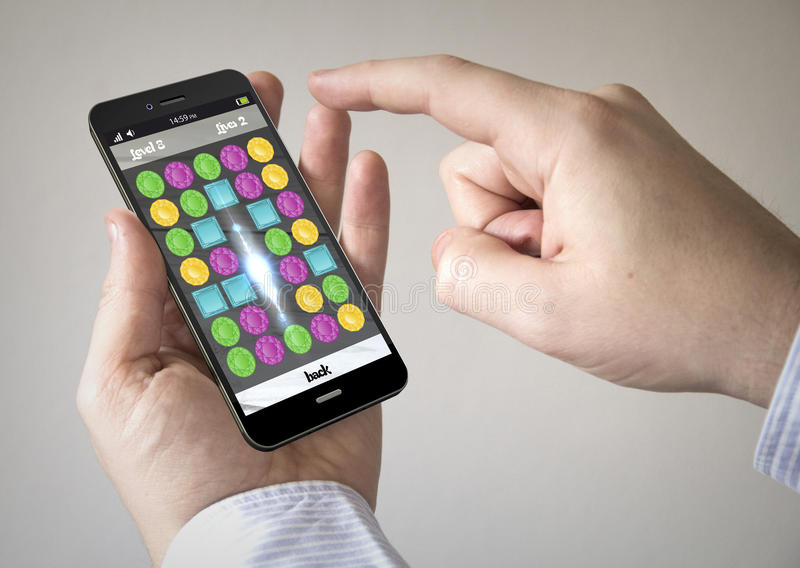 Touchscreen smartphone with puzzle game on the screen. Close up of man using 3d generated mobile smart phone with puzzle game on the screen. Screen graphics are royalty free illustration