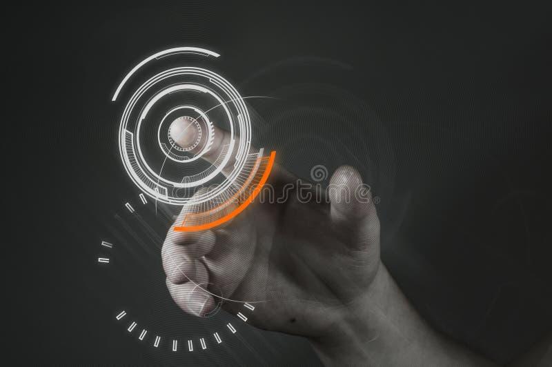 Touchscreen Technology. A man touching a futuristic button
