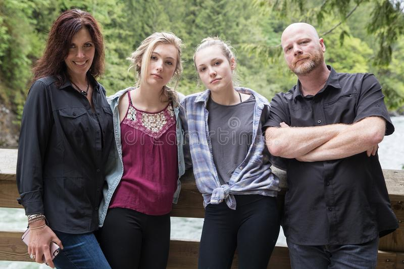 Tough family of four. Family of four with tough and serious expressions stock photo