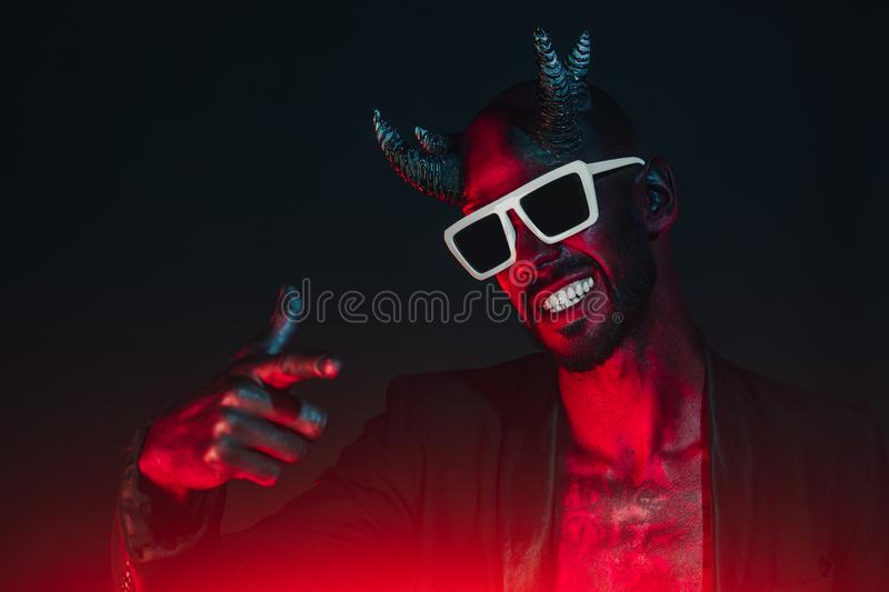 Tough guy in devil suit royalty free stock images