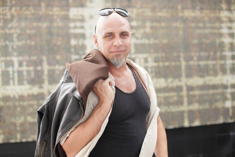 Download Tough Guy With Jacket Over Shoulder Stock Image - Image: 23172731