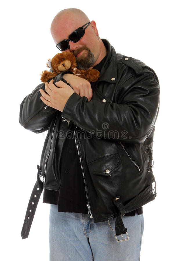Tough guy with a teddy bear stock photo