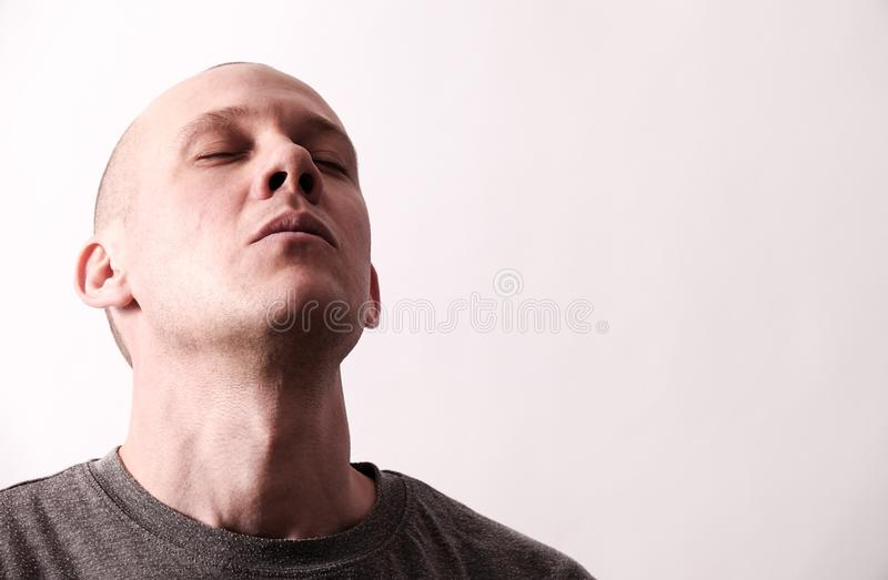Tough looking guy takes a deep breath royalty free stock photo