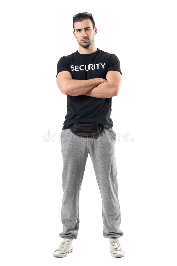 Tough macho bouncer wearing waist bag with crossed arms looking at camera stock photo