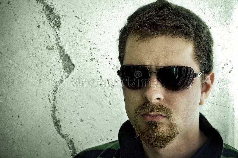 Download Tough Man In Front Of Grunge Wall Stock Photo - Image: 5440520