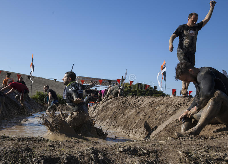 Tough mudder 2015 London South. HAMPSHIRE, UK - SEPTEMBER 26, 2015: Tough Mudder is a team-oriented 10-12 mile (18-20 km) obstacle course designed to test royalty free stock photo