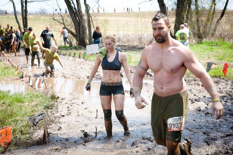 Download Tough Mudder: Racers Walking Through Mud Editorial Stock Image - Image: 30715654