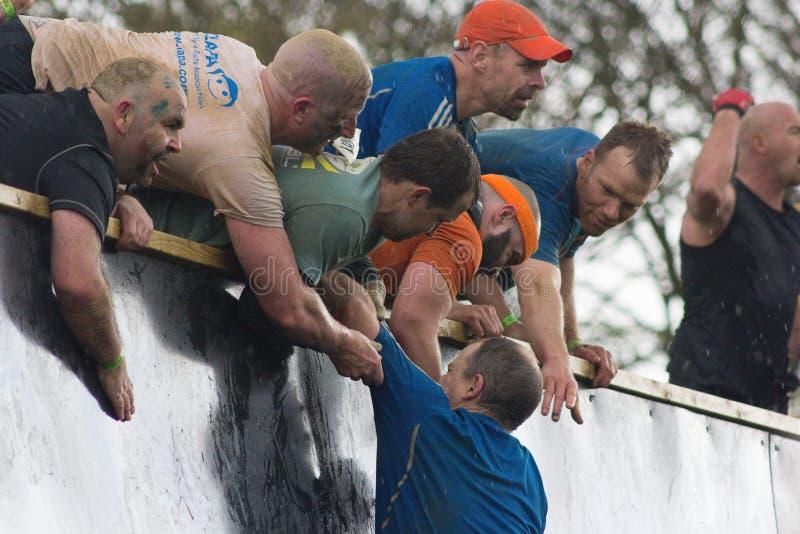 Tough Mudders Climbing Everest royalty free stock image