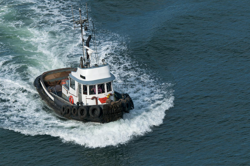 Tough Tugboat. A tough little tugboat royalty free stock photo