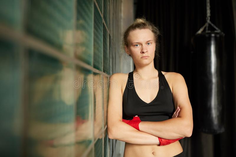 Tough Woman Posing in Gym stock photography