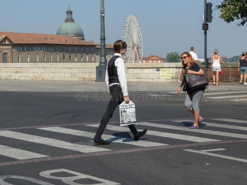 People crossing the street near the Pont neuf in Toulouse royalty free stock photography