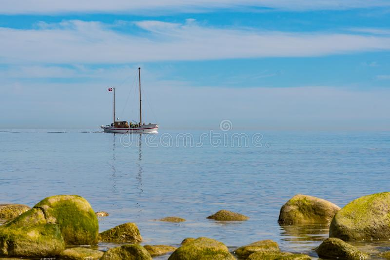 Tour boat Discovery sailing with tourists on the sea of Denmark stock photography