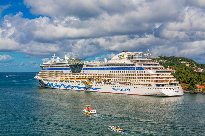 Tour Boats and Aida Diva. CASTRIES, ST LUCIA - November 21, 2016: AIDA Cruises is an American/British-owned German cruise line based in Rostock, Germany. The royalty free stock image