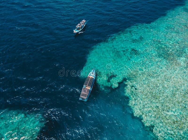 Tour boats in blue ocean on Menjangan island. Aerial view. Tour boats in blue ocean on Menjangan island stock image