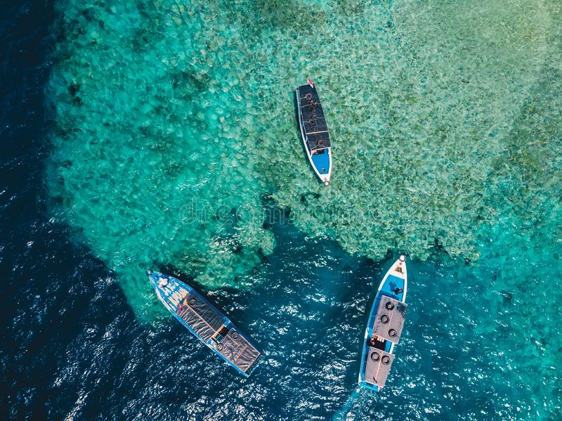 Tour boats at the in ocean on Menjangan island. Aerial view. Tour boats at the in ocean on Menjangan island royalty free stock images