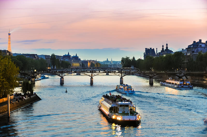 Tour Boats on Seine at Sunset stock images