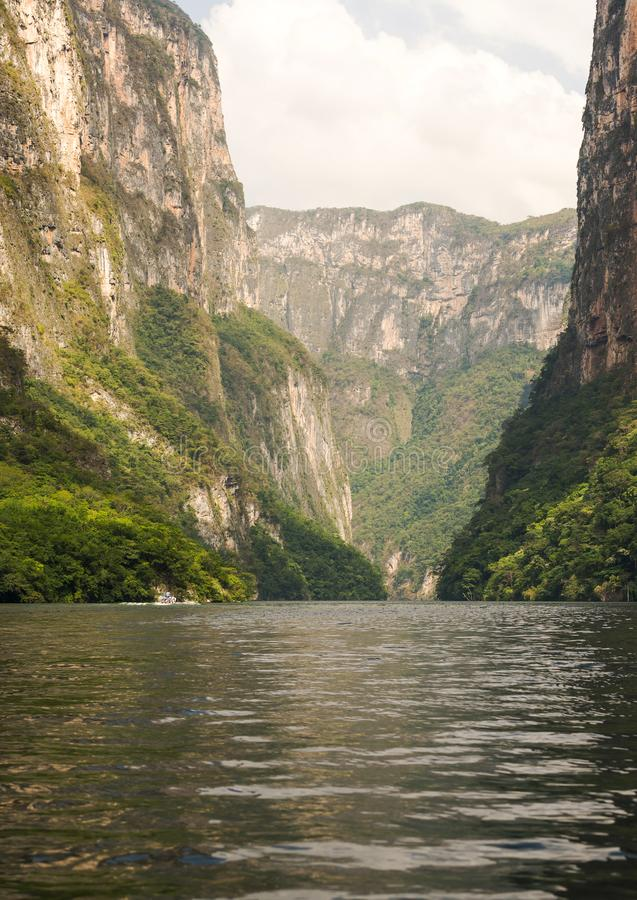 Tour Boats In Sumidero Canyon Mexico. Tour boats and tourists travel through the Sumidero Canyon Chiapas, Mexico stock photo
