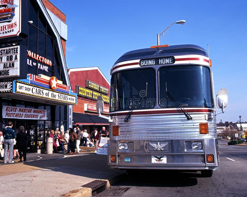 Tour bus on Music Row, Nashville. Tour bus parked outside shops and businesses along Music Row, Nashville, Tennessee, United States of America royalty free stock photography