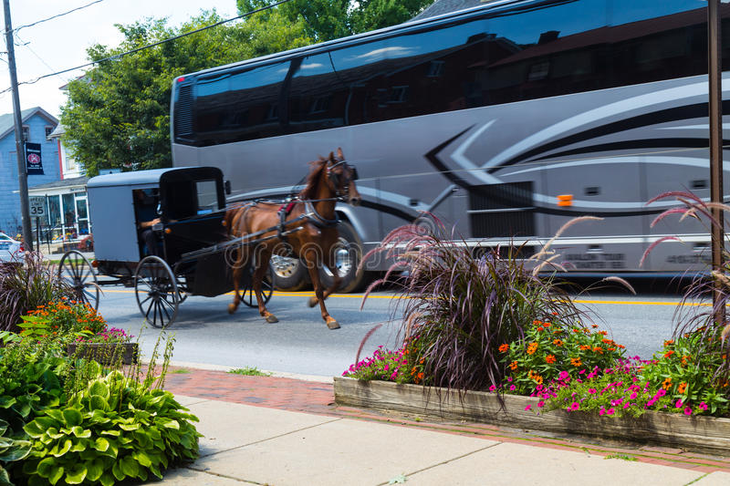 Tour Bus Passing Amish Buggy stock image